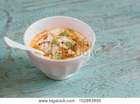 Greek Yogurt With Honey And Nuts In A White Bowl On Blue Wooden Surface, Vintage And Rustic Style