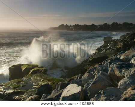 Waves Crashing Against The Breakwater
