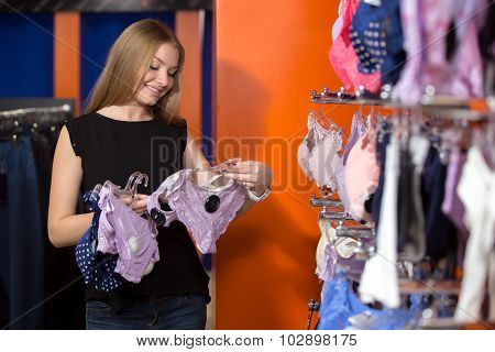 Young Woman Buying Undies