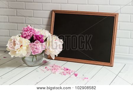 Chalkboard and peonies  in vase