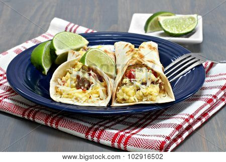 Two Breakfast Tacos With Chorizo, Eggs And Peppers.