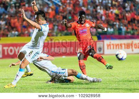 Sisaket Thailand-september 20: O.j. Obatola Of Sisaket Fc. (orange) Shooting Ball During Thai Premie