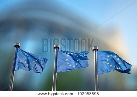 European Union flags in front of the blurred European Parliament in Brussels, Belgium poster