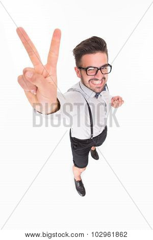 Handsome man showing okay sign in studio