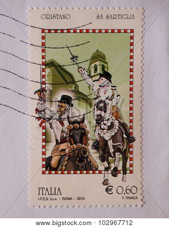 ROME ITALY - CIRCA DECEMBER 2014: 60 eurocent Italian stamp showing traditional masks of Oristano Sardinia