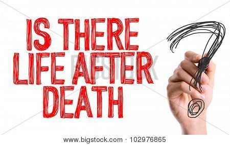 Hand with marker writing: Is There Life After Death?