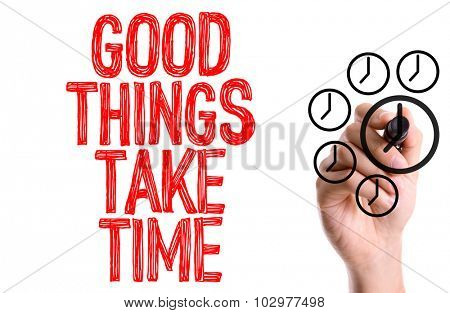 Hand with marker writing: Good Things Take Time poster