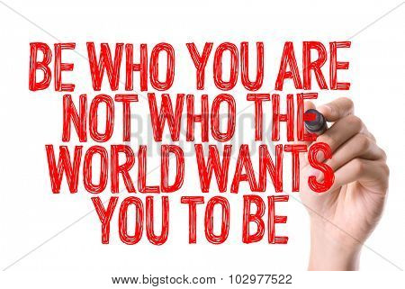 Hand with marker writing: Be Who You Are Not Who The World Wants You To Be