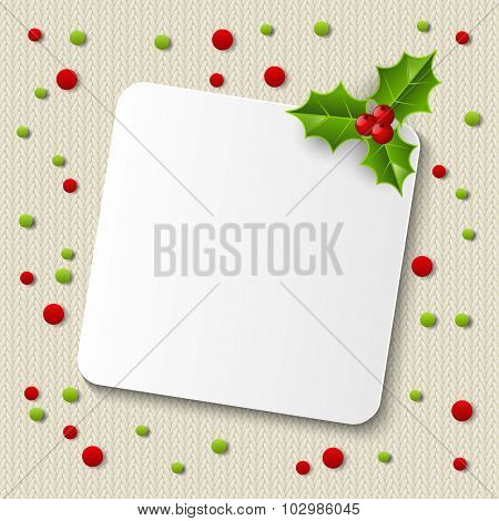 Paper card on knitted background
