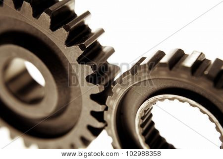 Closeup of two metal cog gears poster