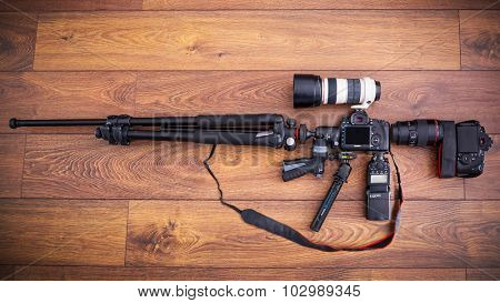 GDANSK, POLAND - APRIL 9 , 2015: Canon cameras and lenses with tripod and other photo equipment in the shape of the machine gun.