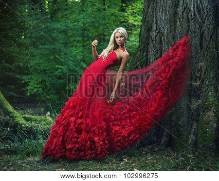 Dreamy blonde beauty posing in a mystic forest