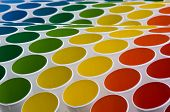 colourful display made from white buckets with coloured interior. poster