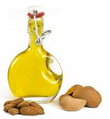 Almond Oil in a glass swing top bottle showing picked almonds often used for cooking therapy cosmetics and well being. On a white background with room for copy space and text. poster