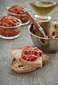Balkan Relish of roasted red peppers and eggplants (Ajvar) on toast slices. poster