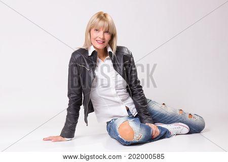 Mature Blond Woman 40S Sitting On Floor