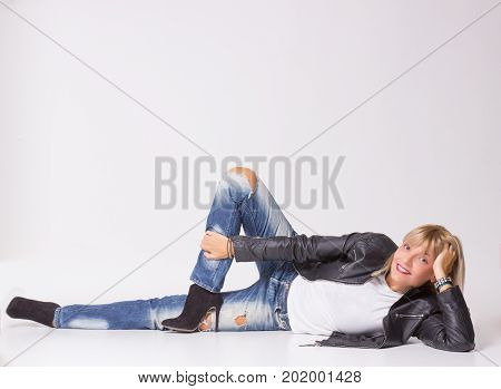 Mature Woman 40S Lying Sideways On Floor, Looking At Camera.