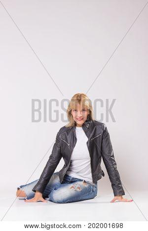 Mature Woman 40S Sitting On Floor, Retro Style.