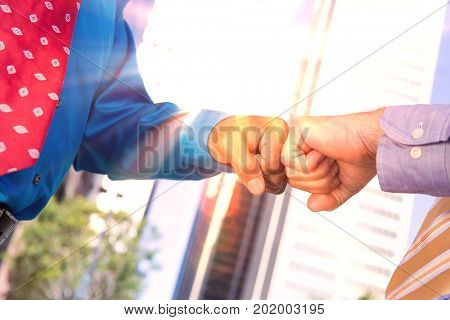Close-up of businessmen greeting eachother, outdoors