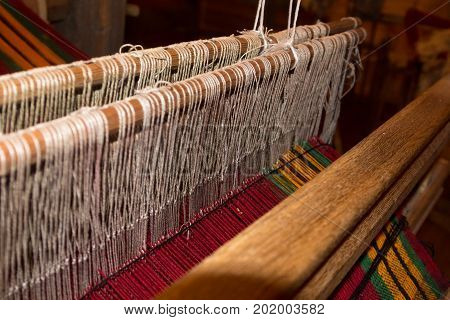 Traditional weaving and a shuttle on machine
