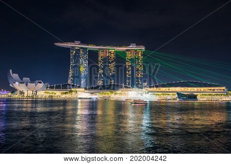 SINGAPORE - October 23 2016 : Illuminate of lights at Marina Bay Sand. Singapore Marina Bay cityscape.