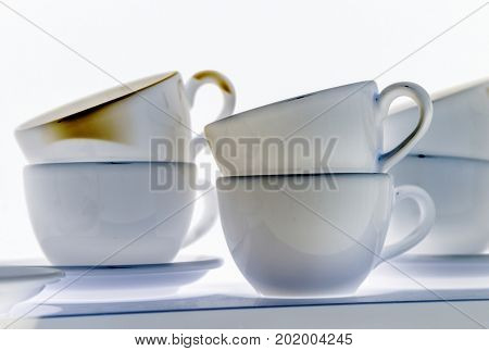 Creative image set of images of plates and white cups utensils styling design retro style Inversion