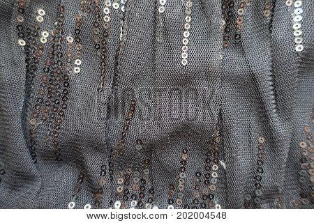 Draped Black Gauzy Fabric With Shiny Paillettes