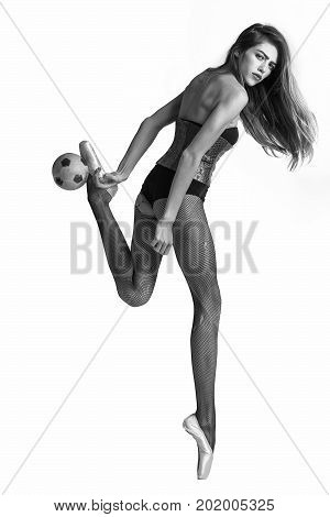 ballerina girl football player or woman with long hair and legs in pointe shoes and body suit with ball black and white