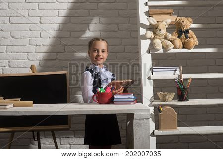 Kid In Classroom On White Brick Wall Background