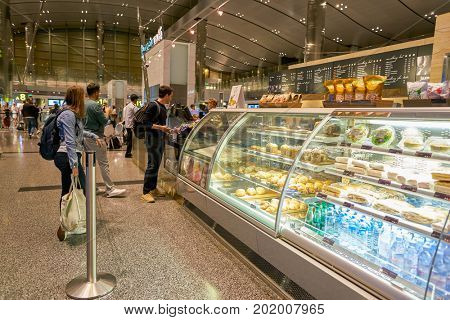 DOHA, QATAR - CIRCA MAY, 2017: cafe at Hamad International Airport of Doha, the capital city of Qatar.