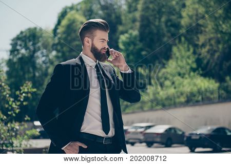 Busy Young Authoritative Red Bearded Stylish Man In Formalwear Talking On Mobile Phone On The Street