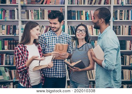 Unity And Connection Of People. Four Multi Ethnic Students Friends, Discussing The Books They Read,