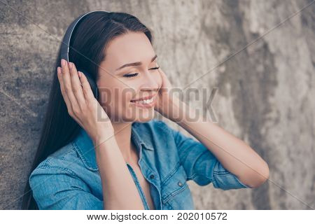 Charming Young Girl With Toothy Smile Is So Dreamy And Happy, Listening To Her Favourite Song, Holdi