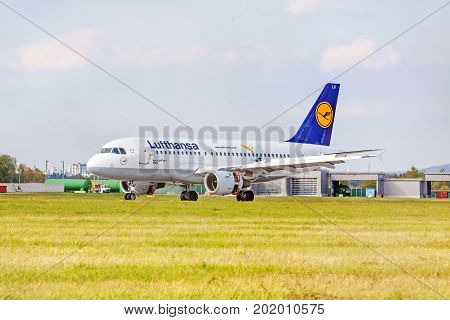 Stuttgart Germany - April 29 2017: Airbus airplane A319-100 from Lufthansa on runway airport Stuttgart - meadow in front