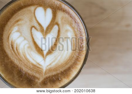 coffee latte art espresso in coffee shop vintage color tone.Cappuccino with beautiful foam coffee cup. Latte art heart shape top view