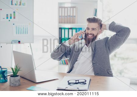 Smiling Bearded Man In Formalwear  Having A Talk With His Business Partners While Sitting At Office,