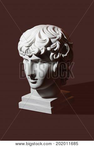 Gypsum head of Antenoy on dark background