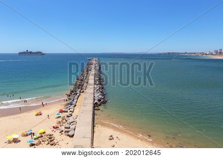 Pierce breakwater Marina of the city of Portimao. Cruise ship in the background.