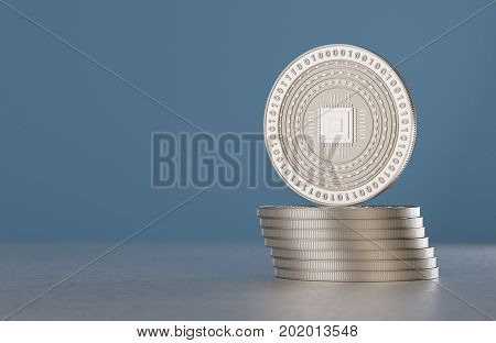 Stack of silver crypto-currency coins with cpu symbol as example for digital currency online banking or fin-tech