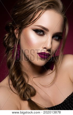 Glamour portrait of beautiful girl model with makeup and romantic hairstyle. Fashion shiny highlighter on skin, sexy gloss lips make-up and dark eyebrows. Pink lips