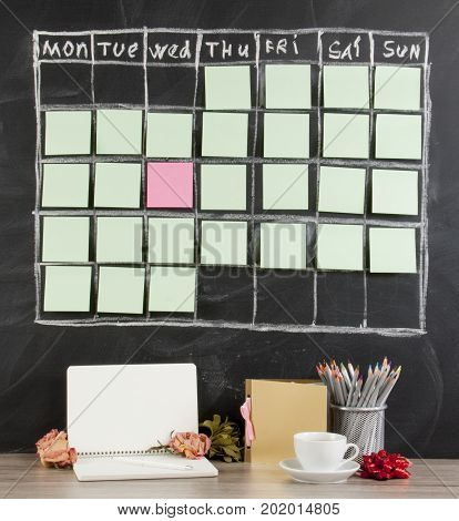 Valentines Day concept: grid timetable schedule with decoration on black chalkboard background