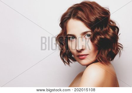 Studio Portrait Of  Young  Woman With Curly Hair Style On Gray. Natural Beauty Concept.