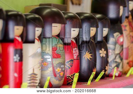 MIYAJIMA JAPAN - AUGUST 21 2015: Kokeshi japanese wooden dolls at gift store