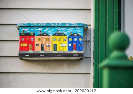 Colorful mailbox with wooden traditional houses in St. Johns New Foundland Canada