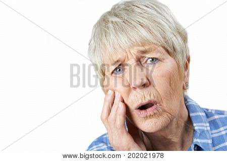 Studio Portrait Of Senior Woman Suffering With Toothache