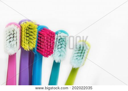 New color ultra fine toothbrushes in colorful glasses. Dental Industry. various types of toothbrushes. Beautiful smile concept. Whitening. Tooth care. Teeth healthy concept. Copyspace.