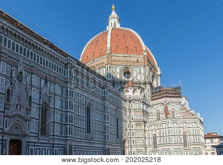View on the Brunelleschi's Dome in Florence Italy. Photographed against clear blue sky.