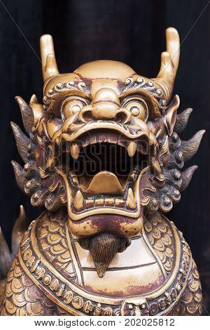 Dragon bronze statue in a chinese buddhist temple, Chengdu, China