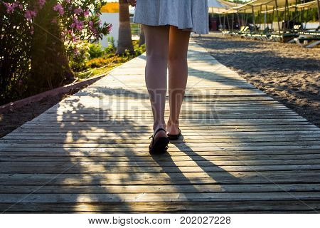 Young Woman Walking On Summer Beach