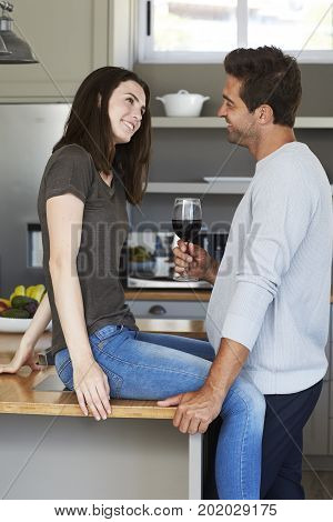 Handsome Kitchen couple in love over wine